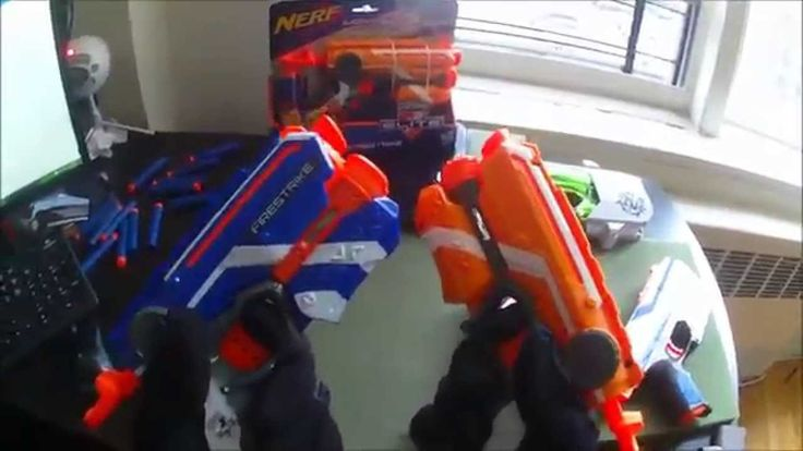 Hey guys! This is Blee from Nerf Gun Attachments (dotcom). Here today, we will be doing a quick little comparison firing test between two of the most popular single fire, front-loaded, Nerf blasters. First up, we have two Nerf Elite Firestrike blasters. I'll be using one orange XD Firestrike and one regular blue Elite Firestrike. Next, we have the Nerf Zombie Strike Sidestrike blaster. For the Zombie blaster I'll be using the guns from the K-Mart exclusive Sidestrike 2 pack. Watch now!
