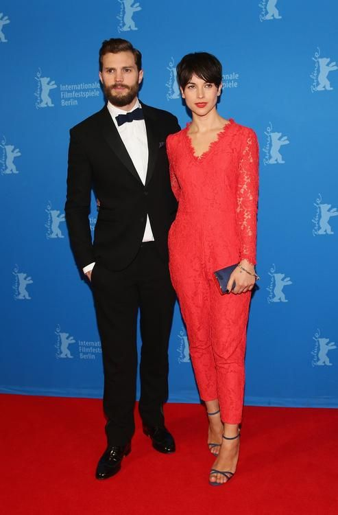"Jamie Dornan's Wife Amelia Warner Steals the Spotlight at ""50 Shades of Grey"" Premieres ~~ At Wednesday night's Berlin Film Festival showing, 32-year-old Amelia Warner stole the spotlight in a red hot jumpsuit well-suited to the film's Valentine's Day premiere."