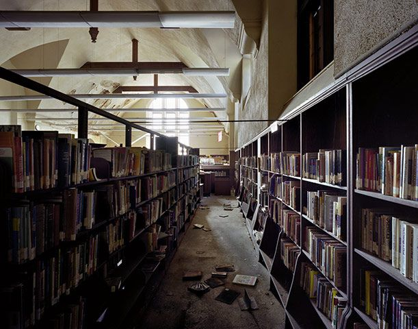 library abandoned buildings in Detroit.   How do you abandon a public library and leave all the books?