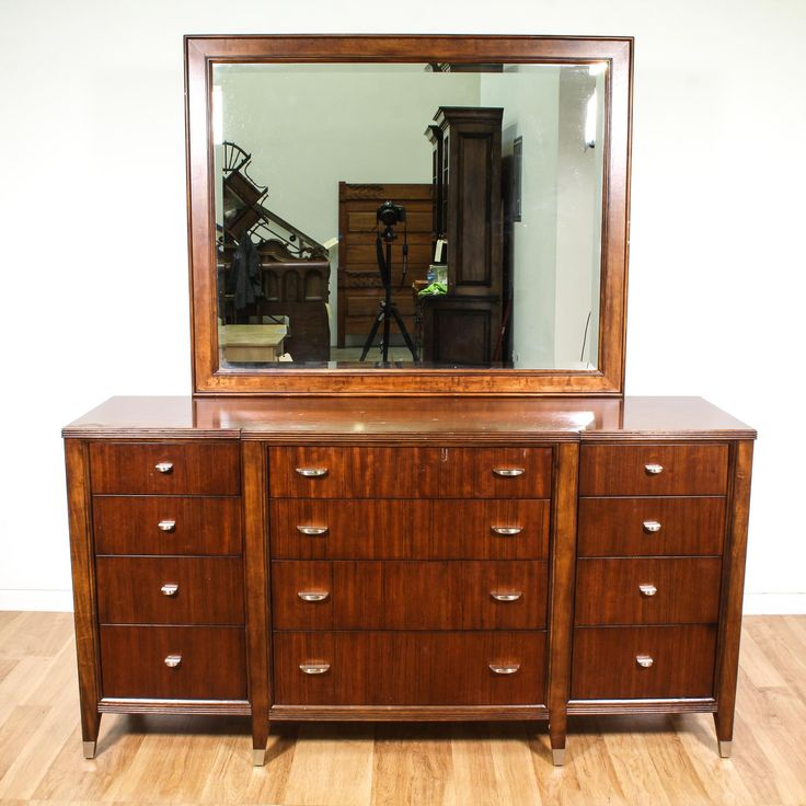 This contemporary dresser and mirror are featured in a solid wood with a glossy gorgeous cherry finish. This long dresser has 12 spacious drawers, brass accents and a large beveled edge mirror. Perfect for storing clothing for additional closet space! #contemporary #dressers #longdresser #sandiegovintage #vintagefurniture