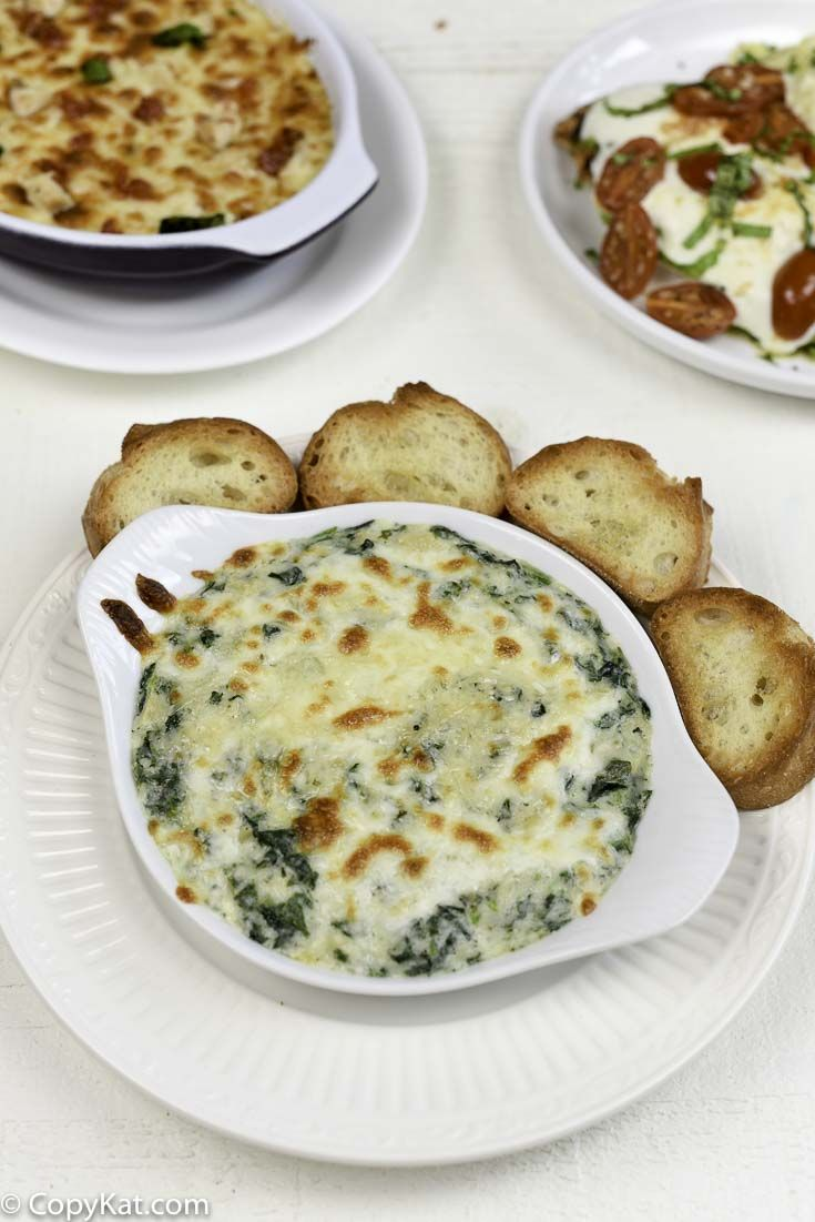 Copycat Olive Garden Spinach-Artichoke Dip can be made quick and easy at home with this copycat recipe. Make this at home tonight.