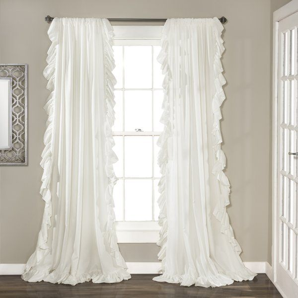 Victorian romance meets regal style with this ruffled curtain panel, awash in a soft neutral hue. Group it with classic damask rugs, diamond-tufted seating, bombe chests, and scrolling chandeliers, for a glamorous take on a time-tested look.