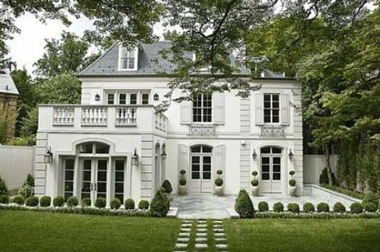 This large stucco house appears to be a French or Mediterranean style.