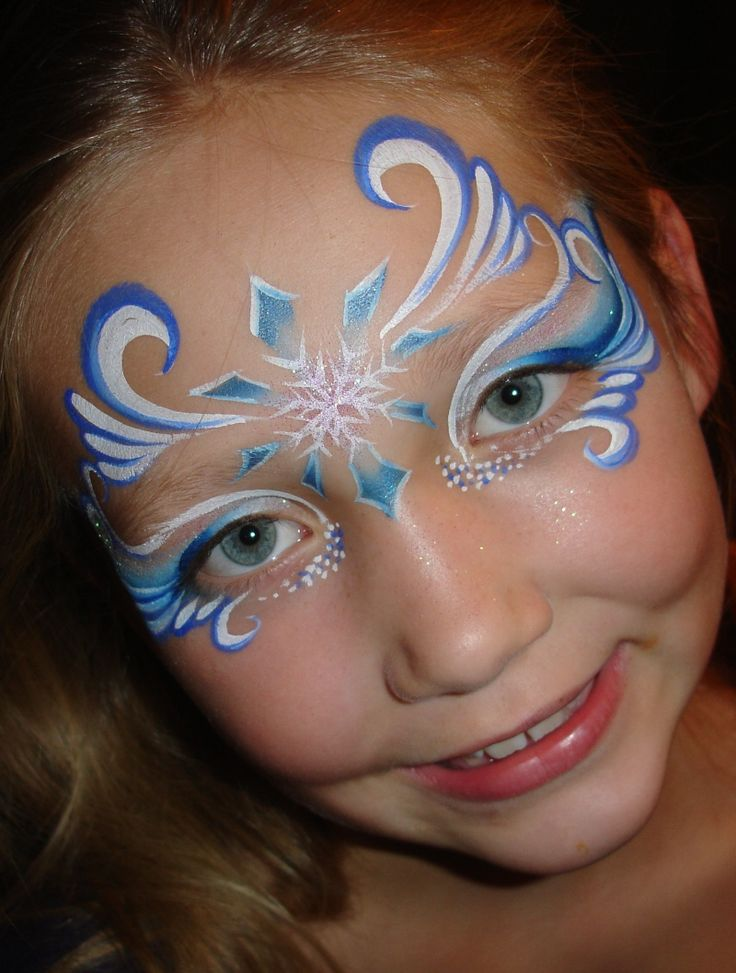Blue swirly teardrop girl design face painting