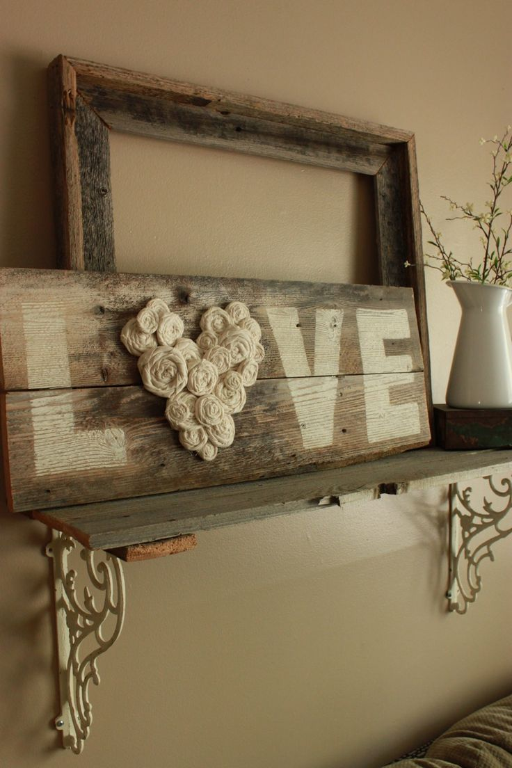 'LOVE' written on a piece of unfinished wood except for the 'O'...make this using handmade rag flowers in the shape of a heart.
