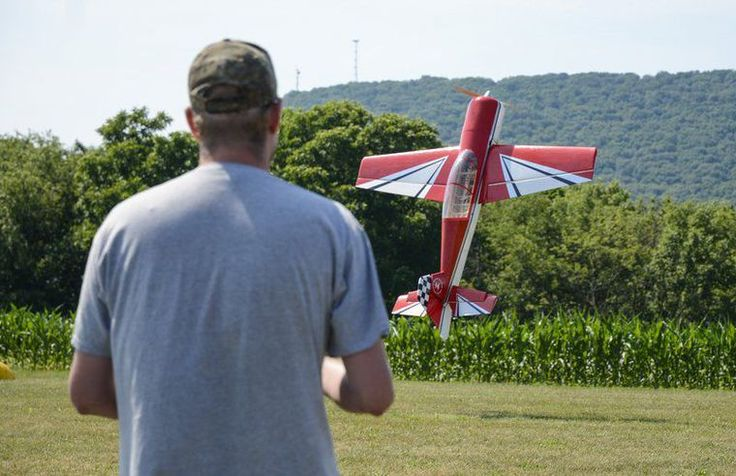 Robert Inglis/The Daily Item Ryan Nau of Williamstown keeps his model air plane hovering above the ground on Sunday during the second annual Carl Bredbenner fly-in put on by the Aerobats Flying Club in Pillow.