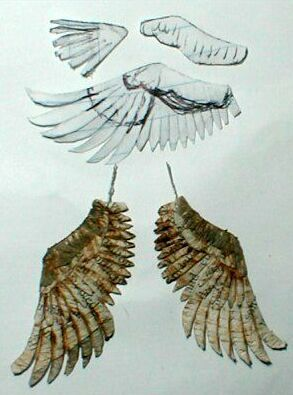 I usually make bird wings by building up several layers of thin sheets of feathers (usually 2-3 ply newsprint),