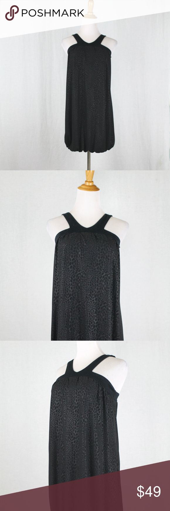 ZARA Evening Black Cheetah Print Mini Dress Black Cheetah print on Black Jersey Shift Dress Bubble hem, sleeveless, Halter Straps with a V neck Very short & flirty. Lining has a wet look, very shiny, silky jersey. The dress itself has a matte effect, with tone on tone cheetah spots. Cotton straps Fully lined. This dress is from 2007. Almost vintage, much better quality than what's in their store now  Looks & feels brand new  Perfect with Guess Leopard fur coat listed poly/lycra blend Made in…