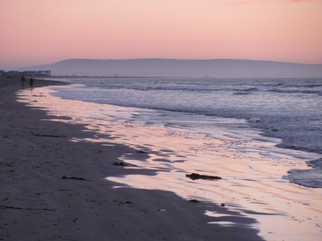 Dwarskersbos beach at sunset...love the way the sky colors the retreating waves, icing the sand in pastel glory