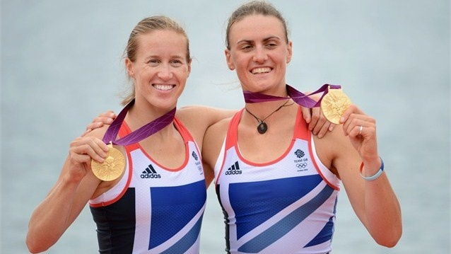 Rowers Helen Glover and Heather Stanning of Great Britain celebrate with their gold medals. Olympics #Olympics