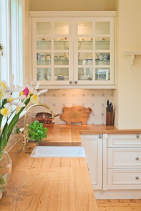 provincial kitchen with solid timber benchtops, butlers sink and tiled splashback