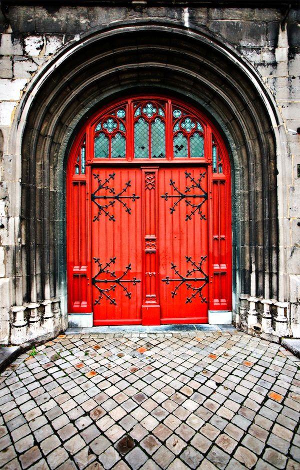 Red church door in Maastricht
