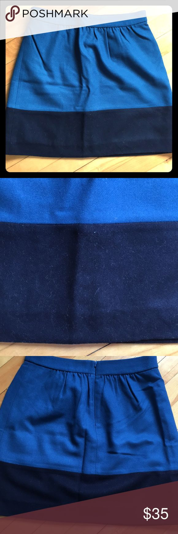 J. Crew wool mini skirt Beautiful turquoise and navy blue wool mini skirt from J. Crew. Pictures make the skirt appear in different shades of blue. Skirt sits just above the hips. Skirt is in new condition - has rarely been worn. J. Crew Skirts Mini