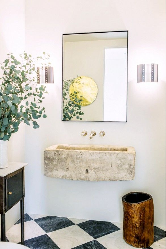 Leigh Herzig's elegant bathroom with a rustic touch featuring a floating stone sink barefootstyling.com