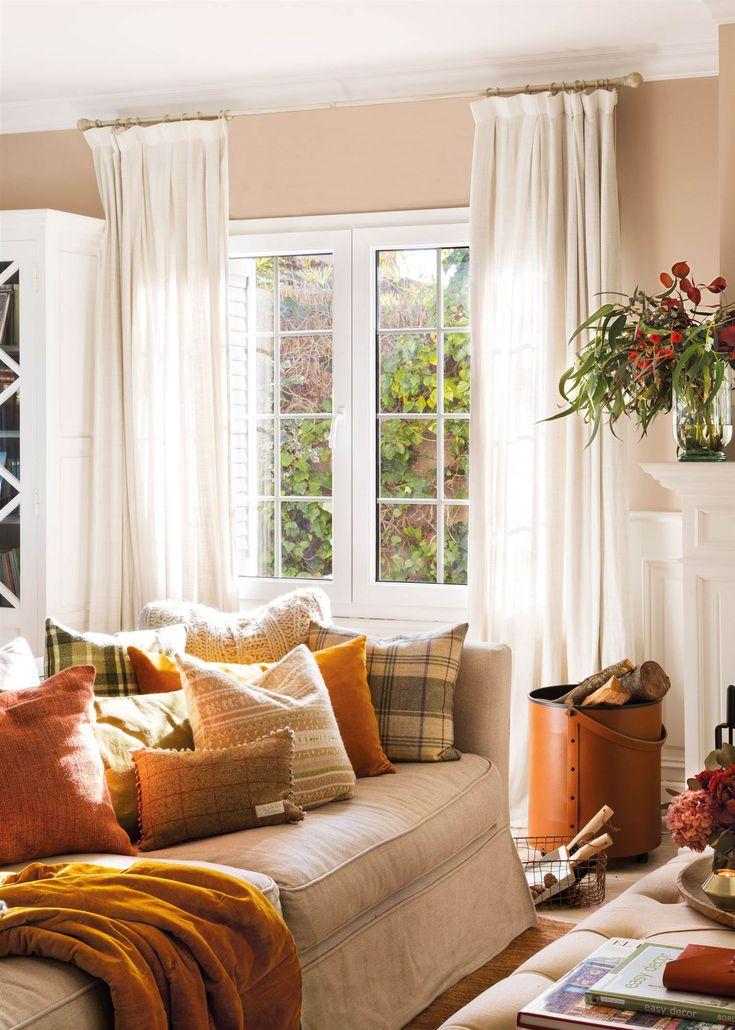 00446879. Salón con sofá, cojines ocres y de cuadros, leñero, ventana con cortinas y estores 00446879