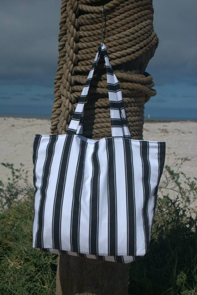 Black stripe beach bag lined with white cotton fabric. Outer made from exterior upholstery fabric.  Measures approx 51x41x15cm. $30.00 each