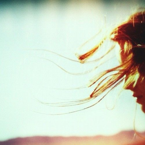 Hair blowing in the summer breeze