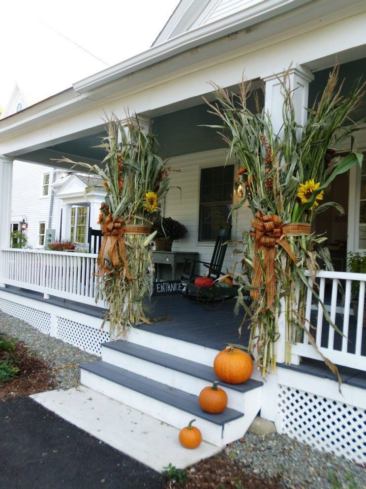 Fall idea for front porch ROCKS AROUND FOUNDATION... Love the cornstalks on post…