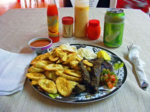 This is plato típico, the national dish of Honduras. Since Honduras is not very fond of spicy food it is not served with any spicy sauces.