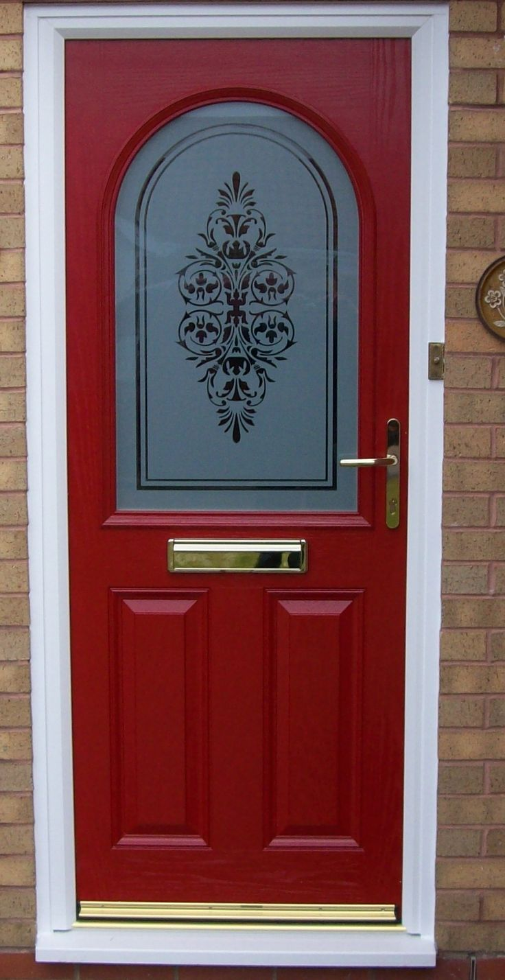 A red composite door with decorative sandblast design installed by image windows