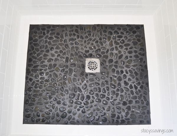 shower-floor black river rock with black grout and subway tile border