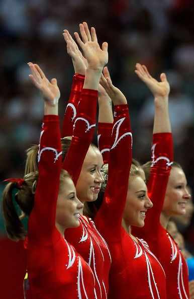 The United States women's gymnastics team celebrate after receiving the silver medal in the artistic gymnastics team event at the National Indoor Stadium during Day 5 of the Beijing 2008 Olympic Games on August 13, 2008 in Beijing, China.