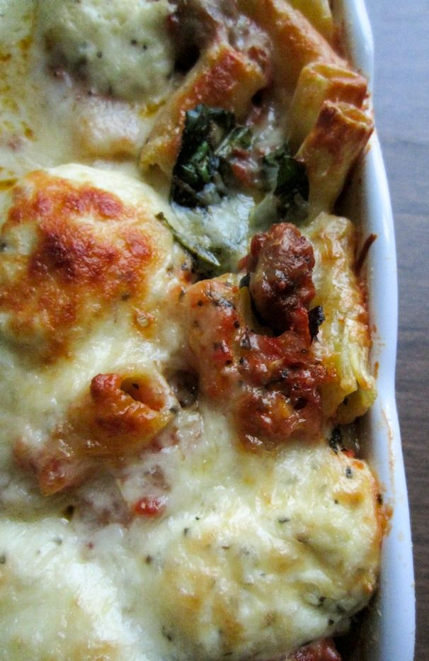 Recipe for Baked Sausage Rigatoni with Spinach - This casserole is soul satisfying in the way only a massive pan of cheesy pasta can be. It is especially delicious when combined with a hunk of crusty bread, some mixed greens dressed in lemon and olive oil.