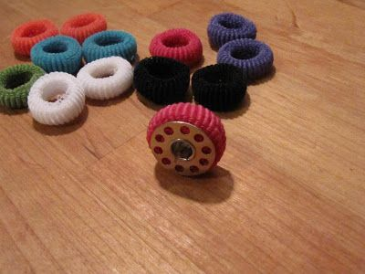 Keep bobbins from unraveling with dollar store mini hair elastics