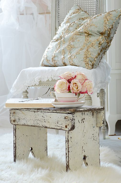 White and faded glamour cushion and chippy stool
