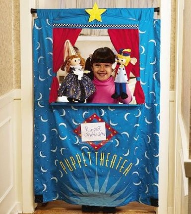 Make a puppet theatre using spring rod and fabric--cut a hole for the show...make your recycle puppets!