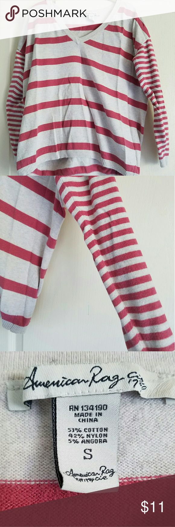 American Rag stripped sweater This is an American Rag stripped pink and cream sweater. It is a V-neck, but not too deep. The middle has larger stripes and the arms have thinner ones. Size S. No ware or stains. American Rag Sweaters V-Necks