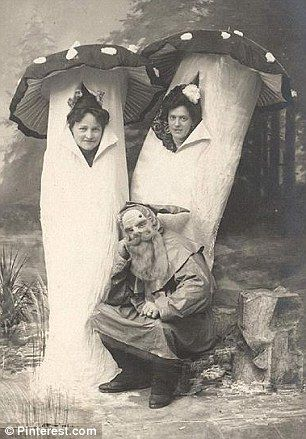 Two women dress as a pair of toadstools with a friend in a beard