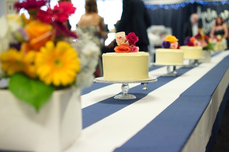 Wedding reception navy and white, bright flowers, dessert reception, cakes, Photography:  Milque Photography