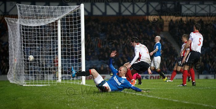 Kenny Miller slides in to score the third goal of the match for Rangers