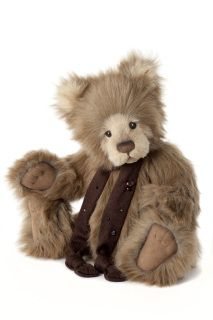 """16.5"""" (42cms) Bear This adorable bear is part of the Charlie Bears Plush collection launched in February 2013. Beamer is delightful bear designed by Bear Artist Isabelle Lee. His shaggy beige fur and pale cream muzzle and pick me up eyes will ensure this bear has a many cuddles as he can get. His paw pads are made from a beige brown coloured leatherette material with toe details and around his neck he wears a brown knitted scarf with beading detail. All Charlie Bears are limited in ..."""