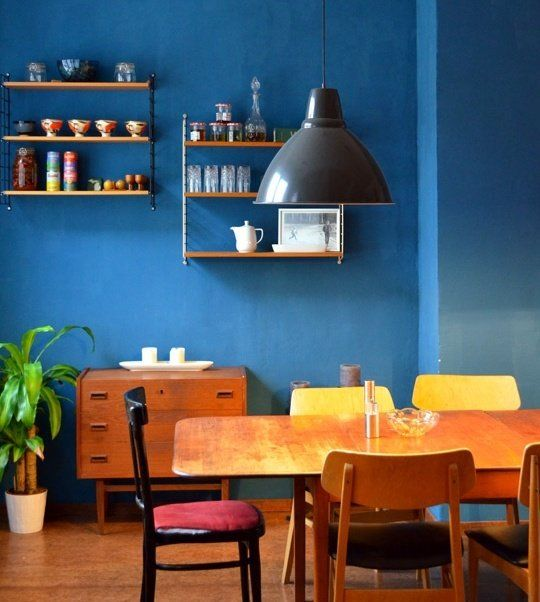 Love this blue wall with warm furniture