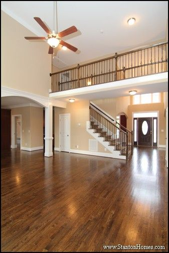 formal dining rooms with columns. two story foyer with barrel vault ceiling. white columns lead to the kitchen, and formal dining rooms o