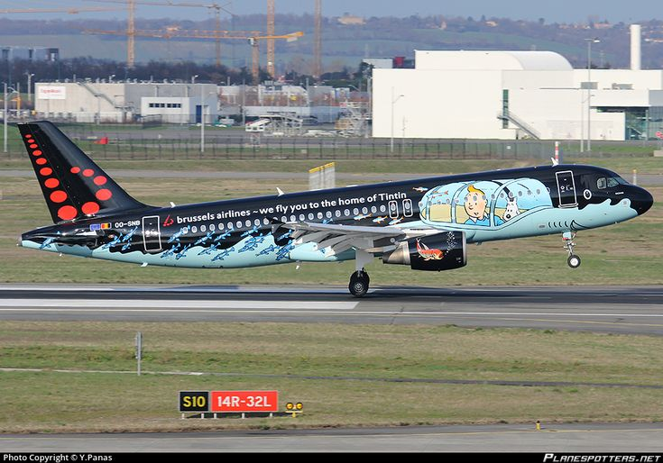 Brussels Airlines Airbus A320-214 OO-SNB aircraft, named ''Rackham'',painted in ''Tintin'' special colours Mar 2015, with the inscription ''we fly you to the home of Tintin'' on the airframe, landing to France Toulouse Blagnac International Airport. 16/03/2015.