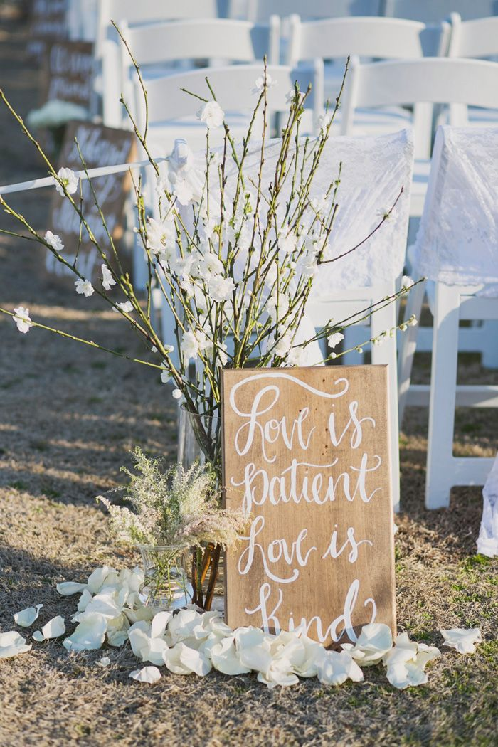Bible verse sign decor for Maggie and Greg's March wedding ceremony! The Sonnet House | Jett Walker Photography