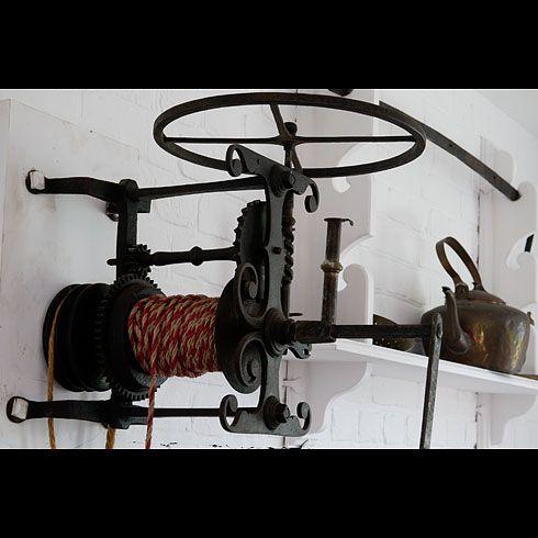 Spit-jack (a clockwork spit-turner for roasting meat). http://regencyredingote.wordpress.com/2011/08/19/kitchen-fireplace-furniture-contraptions-for-cooking/