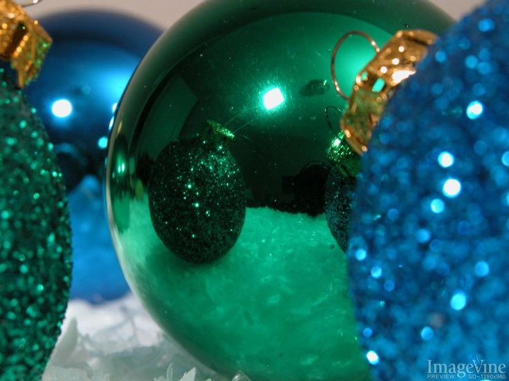 christmas background shiny blue and green christmas ornaments