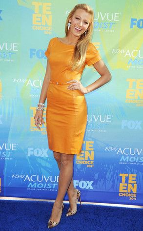 The Gossip Girl actress is the picture of summer fun in this bright orange dress by Gucci paired with animal-print Louboutin pumps at the Teen Choice Awards.