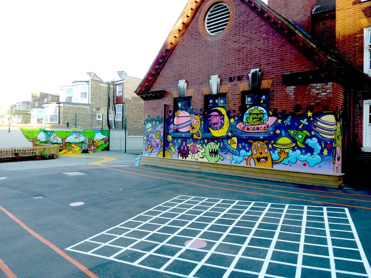 South Harringay Infant School - two bright and vibrant playground murals linked with a yellow brick road.  #outsidemural #handpainted #schoolmural #playgroundmural