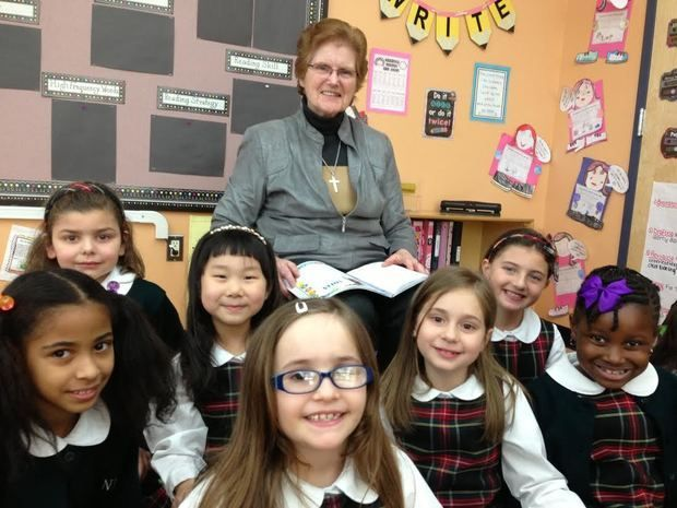 Sister Pat Corley with students at Notre Dame Academy