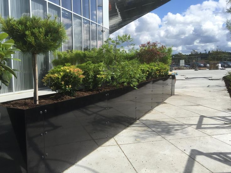 Steel planters with a gloss black finish made to customer specification for Sabi Sushi in Norway. Gloss black planters have been used to create a contemporary and stylish outdoor ambience.