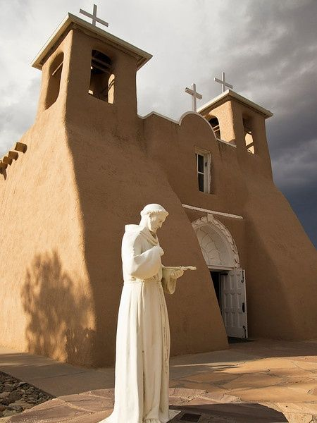 San Francisco de Asis Mission Church in New Mexico...so beautiful it has been photographed by Ansel Adams and painted by Georgia O'Keefe. Visit Santa Fe, rent a cozy historic adobe home in town, good winter rates, walking distance to the plaza, check it out Airbnb 2562597, Winter in New Mexico is beautiful for skiing, snow shoeing and hikes under the full moon.