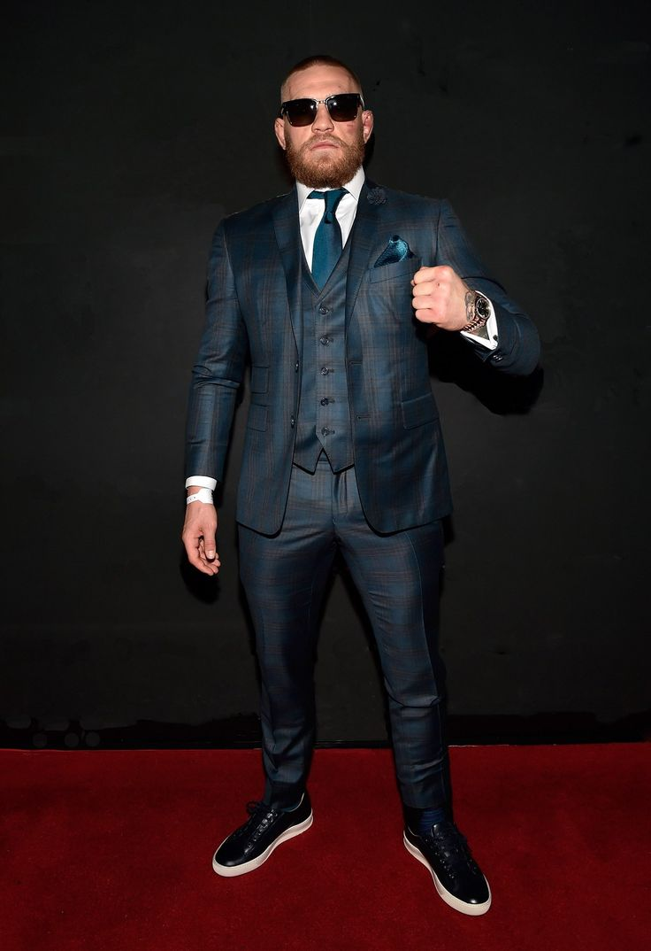 The MMA fighter celebrated his UFC 202 win over Nate Diaz by donning a shiny suit with matching tie and pocket square.