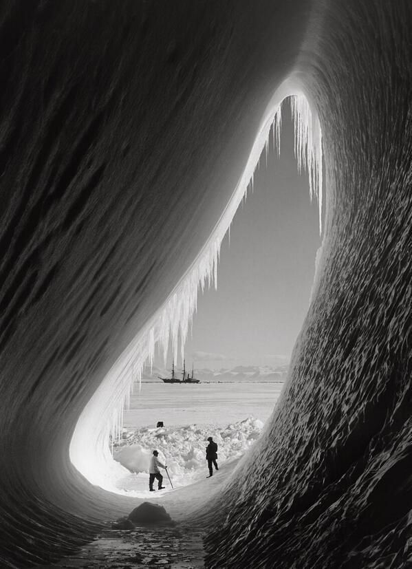 Members of Robert F. Scott's expedition to south pole inside an ice grotto with Terra Nova ship in the distance, 1911 pic.twitter.com/b5BwPoZd4v