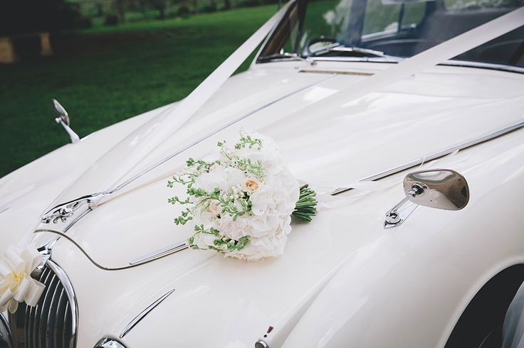 Sally's Bouquet x Photographer - www.emmacleveley.co.uk Bouquet - www.theflowermilldraycott.co.uk Car - www.dennissonclassics.co.uk