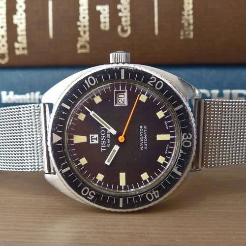 "1972 Tissot [Swiss] Navigator Tropical Dial Vintage Diver Watch ETA Cal. 2481 | ""A wonderful Tissot [Swiss] ""Navigator"" Diving Watch. This 1972 sporty diver is in just an overall great condition both visually and mechanically, with the Automatic ETA Cal. 2481 ticking away happily. The rare ""Tropical"" dial and hands are a feast to the eyes and even still retain a very strong lume. The solid stainless steel C-shaped case is in great condition and has been lightly cleaned [not polished]"""